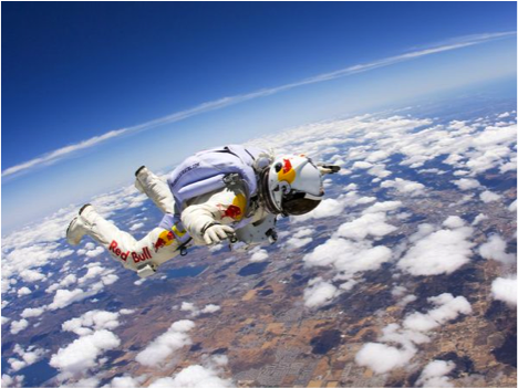 Felix Baumgartner sets world records for highest skydive and longest freefall.